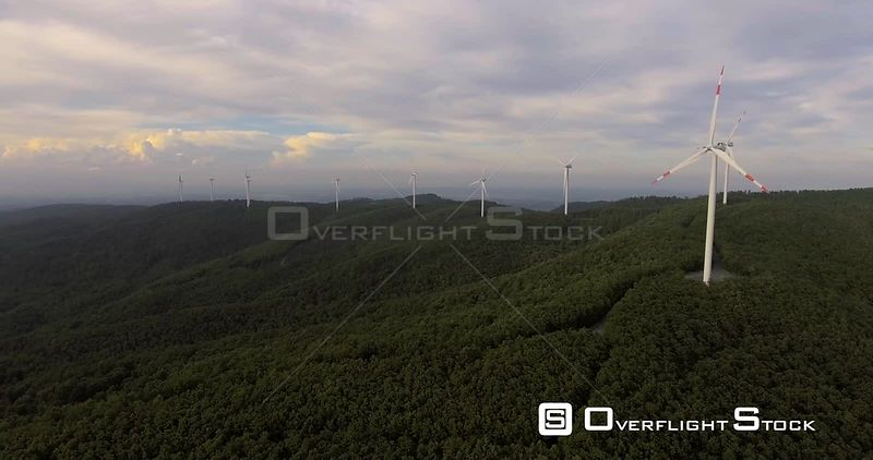 Aerial footage, wind turbines in the green forest, 4k Tuscanu Italy