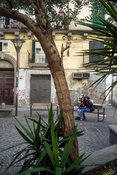 A young couple laugh and flirt in a square Naples