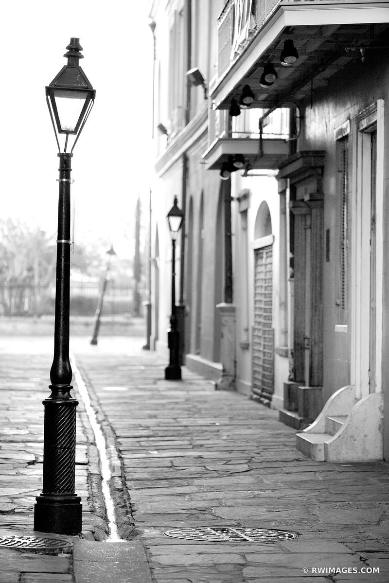 PIRATES ALLEY FRENCH QUARTER NEW ORLEANS LOUISIANA BLACK AND WHITE VERTICAL