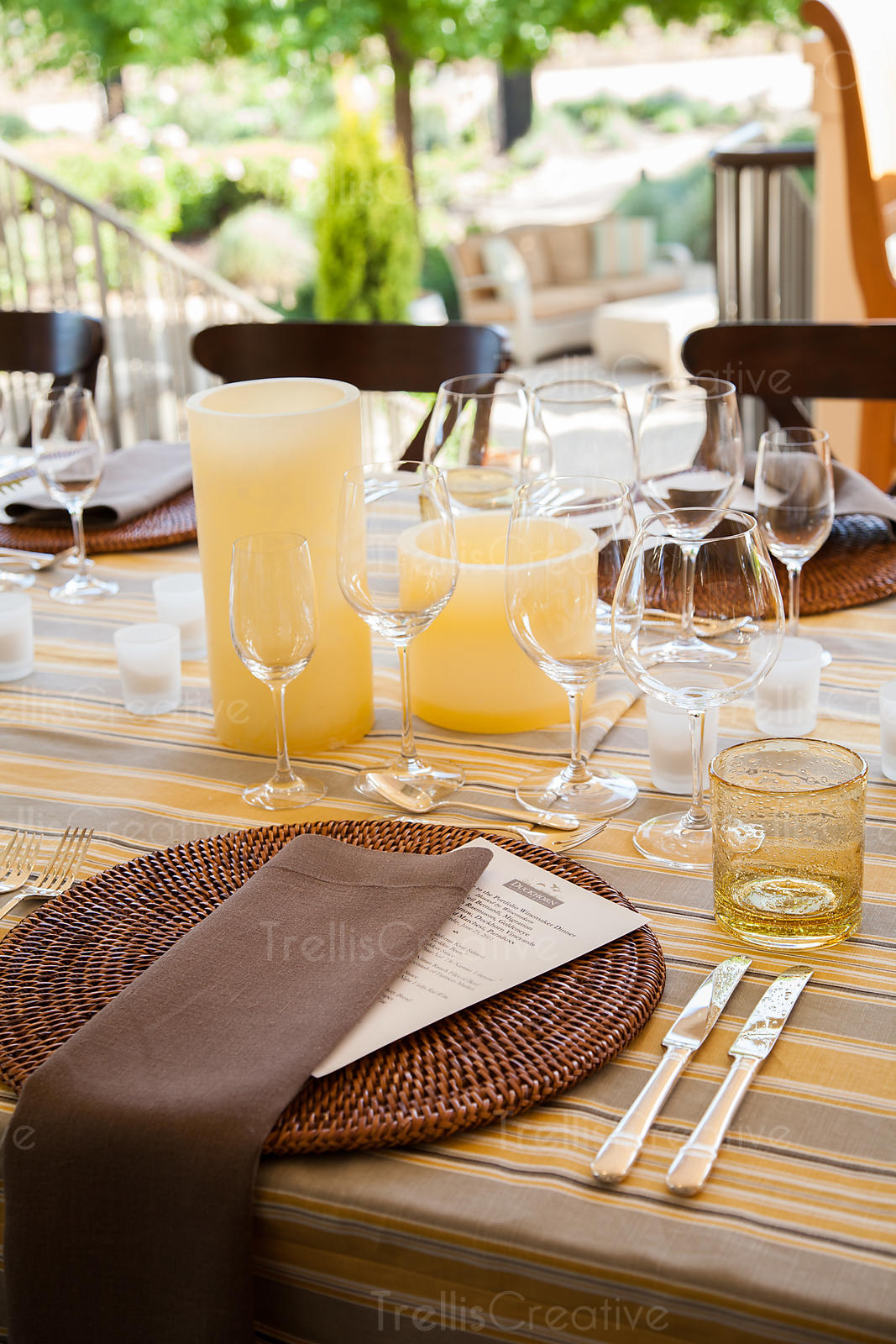 A place setting at a beautifully decorated outdoor dinner table in wine country