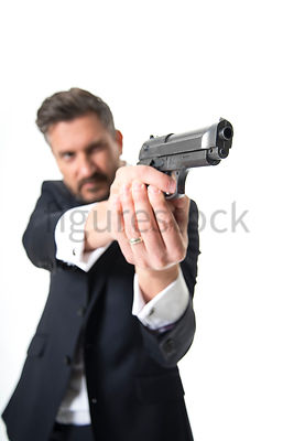 A Figurestock image of a man pointing a gun – shot from mid level.