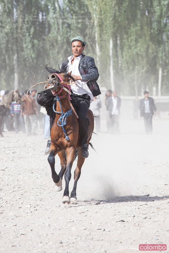 Man riding a horse at Kashgar sunday market, China