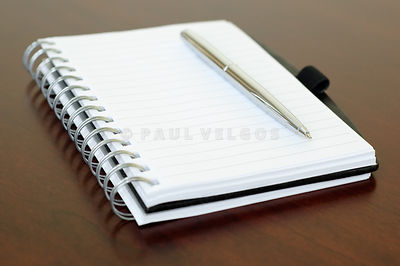 Spiral Notepad and Pen on Desk