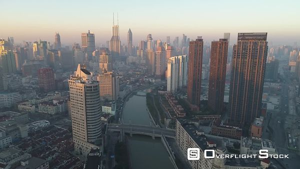 Shanghai Skyline in the Sunny Morning. Puxi District. China. Aerial View. Drone is Flying Forward and Upward. Establishing Shot.