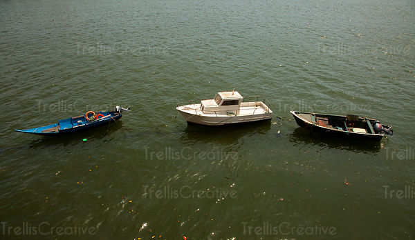 Three small boats on the river