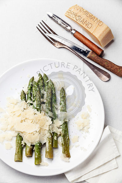 Asparagus with Parmesan cheese on white background