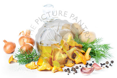 Raw chanterelles with oil and spices on white background