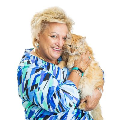 Happy Senior Woman With Cat on White