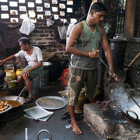 Men making sweets at Seal Sweets in Chandannagar. The town is now famous for its confectionary