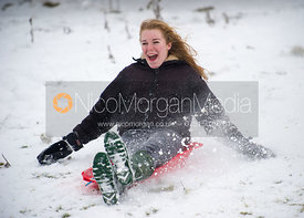 Girl sledging on Burrough Hills, Leicestershire