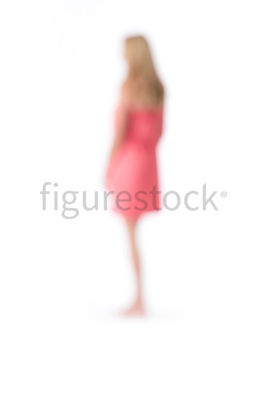An abstract image of a blonde woman in a pink dress – shot from mid level.