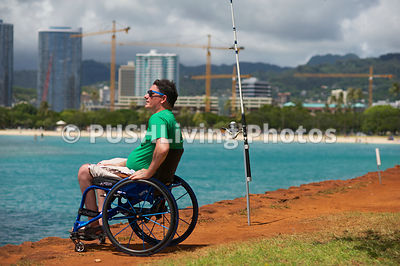 Man in a wheelchair beach fishing in Hawaii