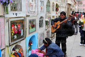 Guitarist playing in cemetery for souls of the deceased, Todos Santos festival, La Paz, Bolivia