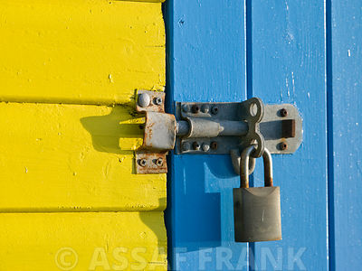 Padlock on beach hut door, Close-up, Littlehampton England