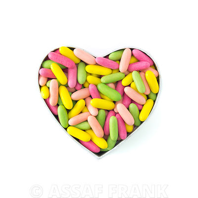 Colorful sweets in heart shape