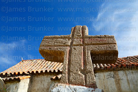 Stone cross on wall of Santo Tomás church, Isluga village, Isluga National Park, Region I, Chile