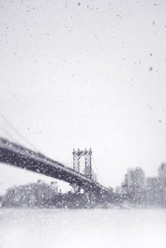 An atmospheric image of the Manhattan bridge, New York City, on a snowy day.