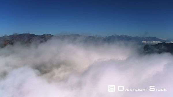 Flying Over Clouds Toward Mount Wilson Observatory in the San Gabriel Mountains, California.