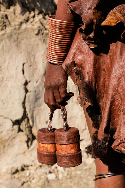 Himba Woman Holding Makeup Containers