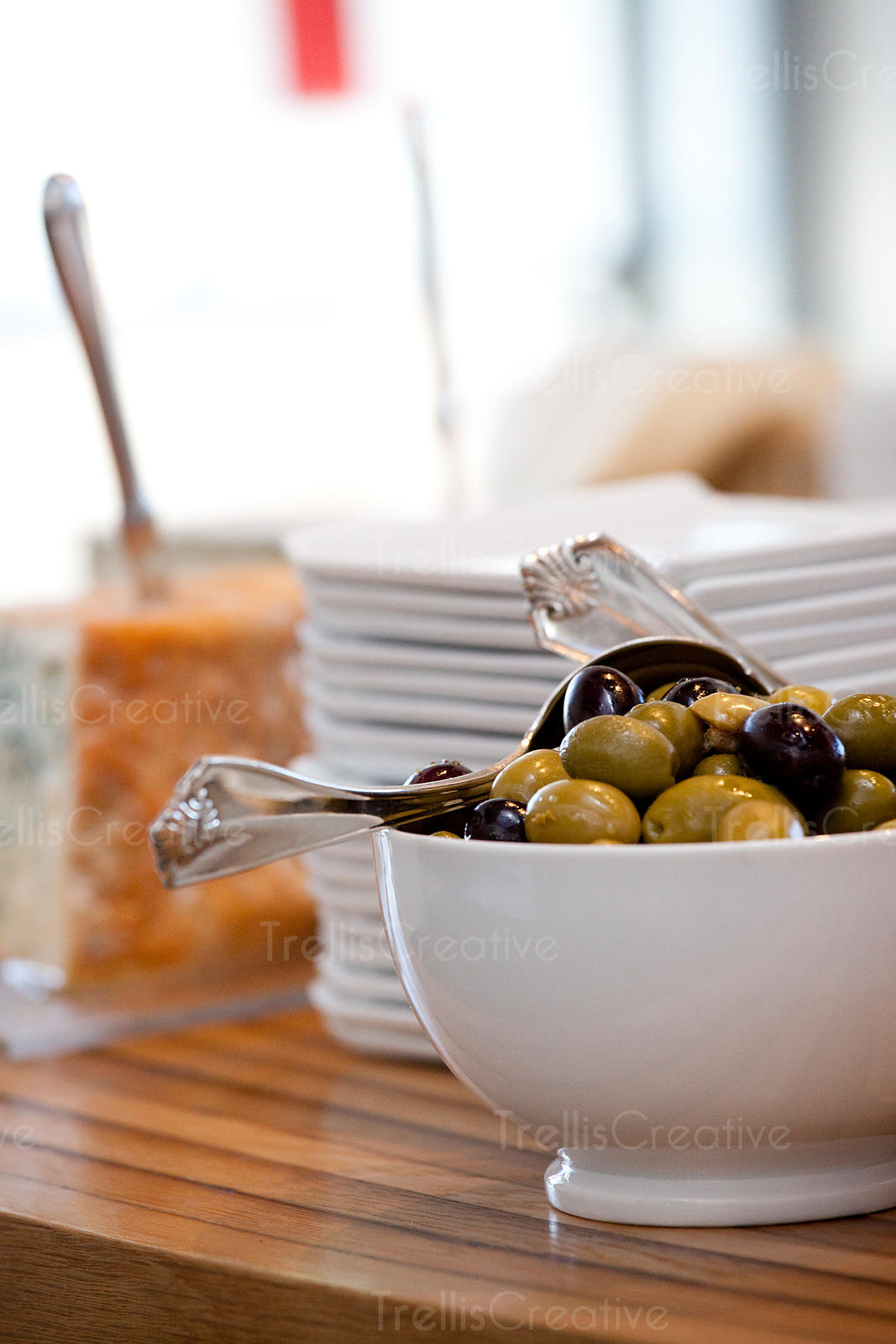 White bowl filled with various marinated olive varieties