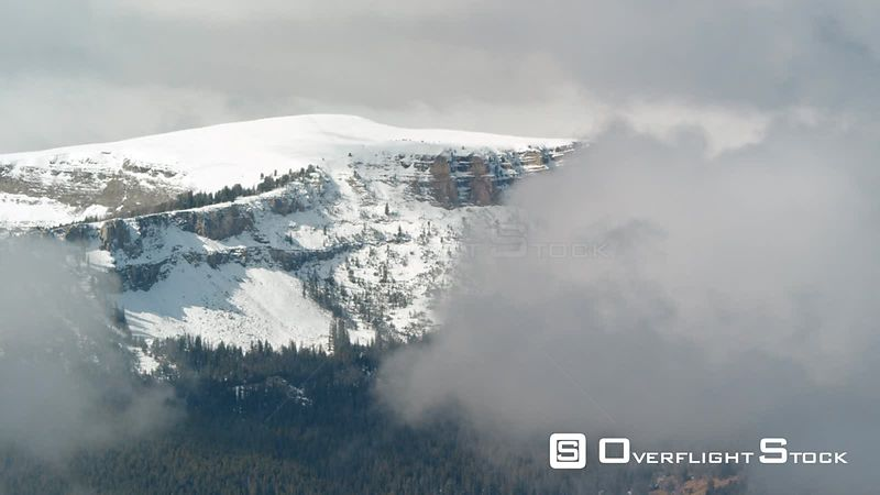 The snow covered peaks and steep cliffs of the Henry's Lake mountains near Yellowstone National Park