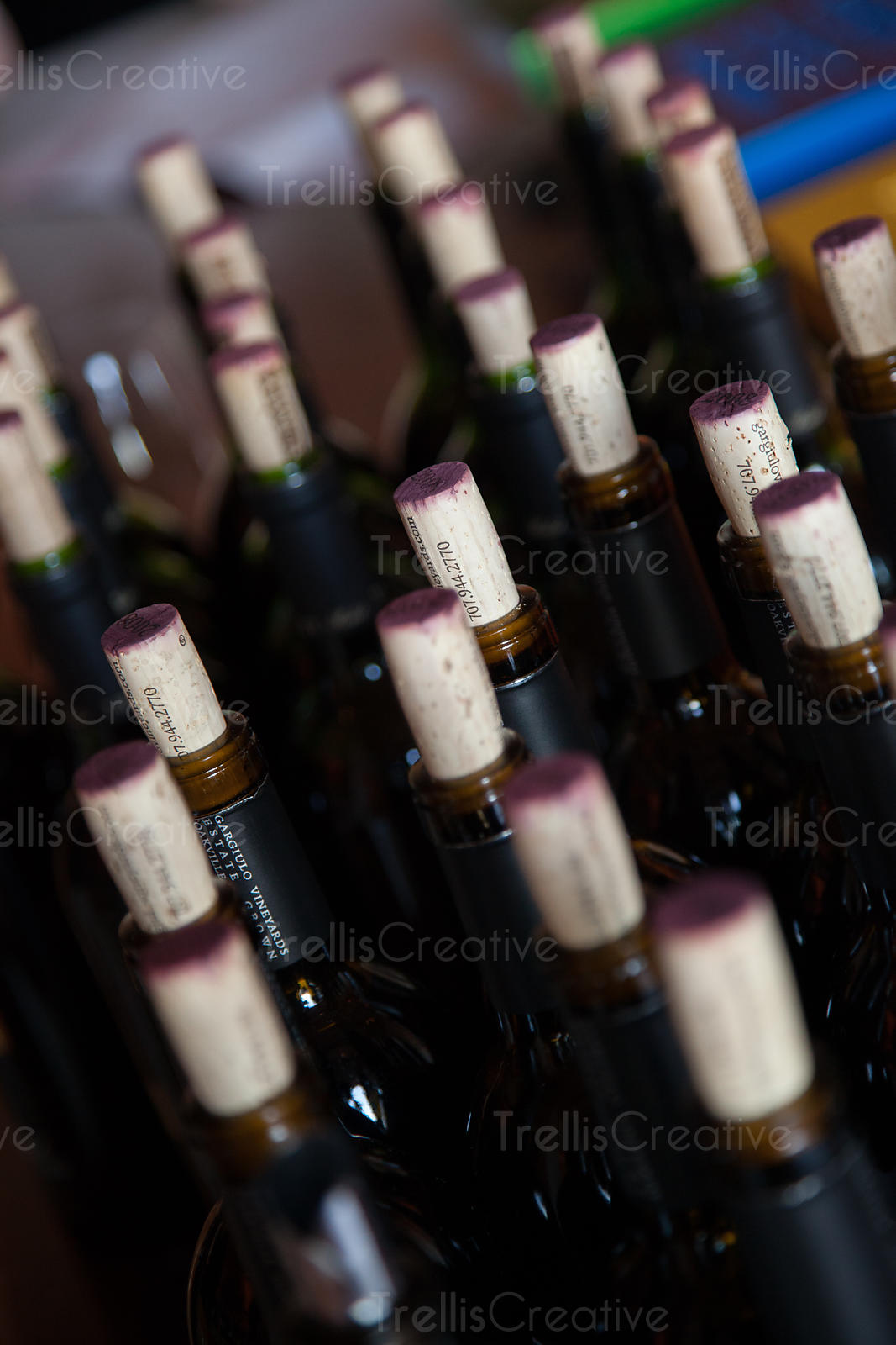 Bottles of open red wine with wine stained corks