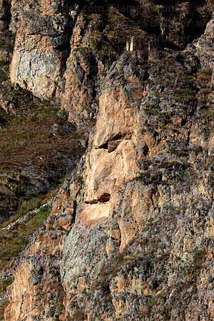 Close up of head of Wiracochan / Tunupa carved into Cerro Pinkuylluna above village of Ollantaytambo, Sacred Valley, Peru