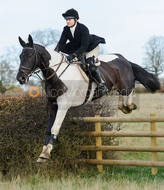 Georgina Mason jumping a fence