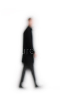 A blurred figure of a man walking – shot from mid level.