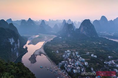 Sunset over Li river and karst peaks, China