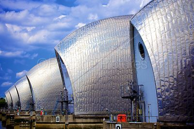 The Thames Barrier at Low Tide with Fluffy Clouds and Blue Sky