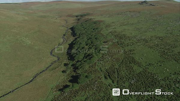 Aerial view tracking over Wistman's Wood, Dartmoor National Park, Devon, England, UK, October 2015.