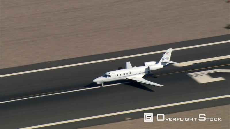 Aerial view of executive jet taxiing and taking off