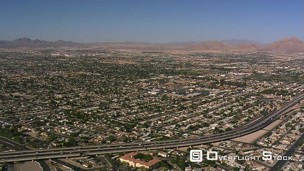 Flight over Las Vegas residential areas paralleling I-15.