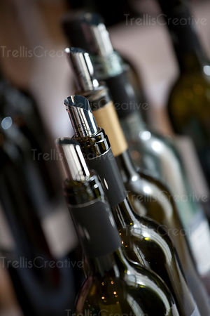 Close-up of the necks of opened wine bottles