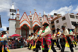 Musicians playing pinkillo flutes in front of Sanctuary of Virgen de la Candelaria, Puno, Peru
