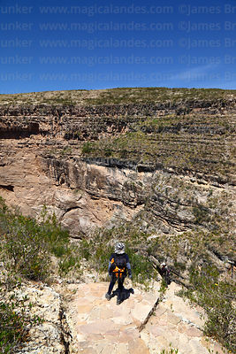 Hiker descending to El Vergel in Torotoro Canyon, Torotoro National Park, Bolivia