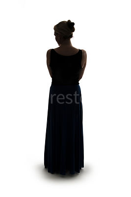 A silhouette of a woman in a long dress – shot from eye level.