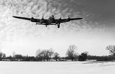 Nearly home - Lancaster limping back in winter black and white version