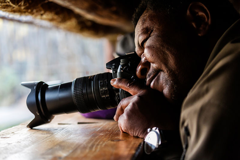 African Safari Guide Taking Photographs