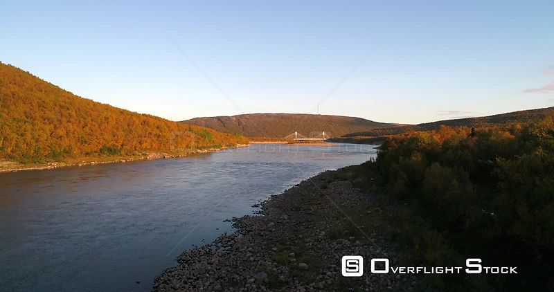 Autumn River, Aerial Rising View of Tenojoki River and Border Bridge Between Norway and Utsjoki Town, on a Sunny Autumn Day, ...