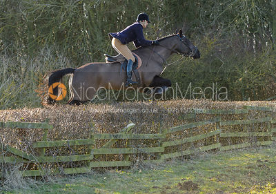 Debbie Barnes jumping a hedge at Town Park Farm - The Cottesmore at Town Park Farm