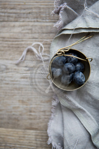 Pot of Blueberries on Linen Cloth & Table