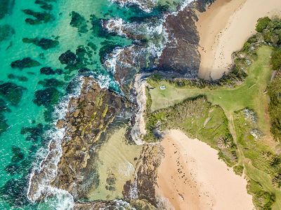Pristine waters off the Illawarra coastal town of Austinmer.  Views of Bells Point Headland a tall narrow peninsula of rocky ...