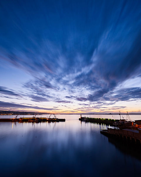 Dawn twilight across the harbour of the fishing port of Newlyn in Cornwall, UK.