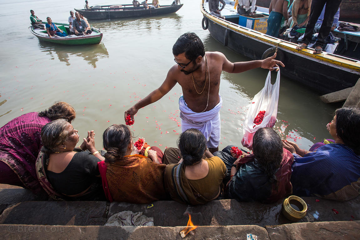 Hindu women offer prayers on the Ganges River, Kedar Ghat, Varanasi, India
