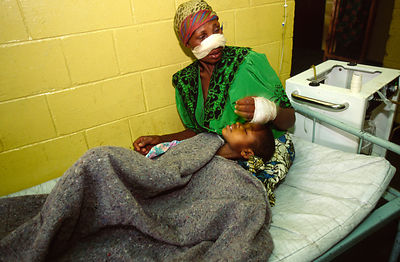 A Tutsi civillian and her son recovr in hospital from an ambush by Interehamwe rebels, Gisenyi, Rwanda