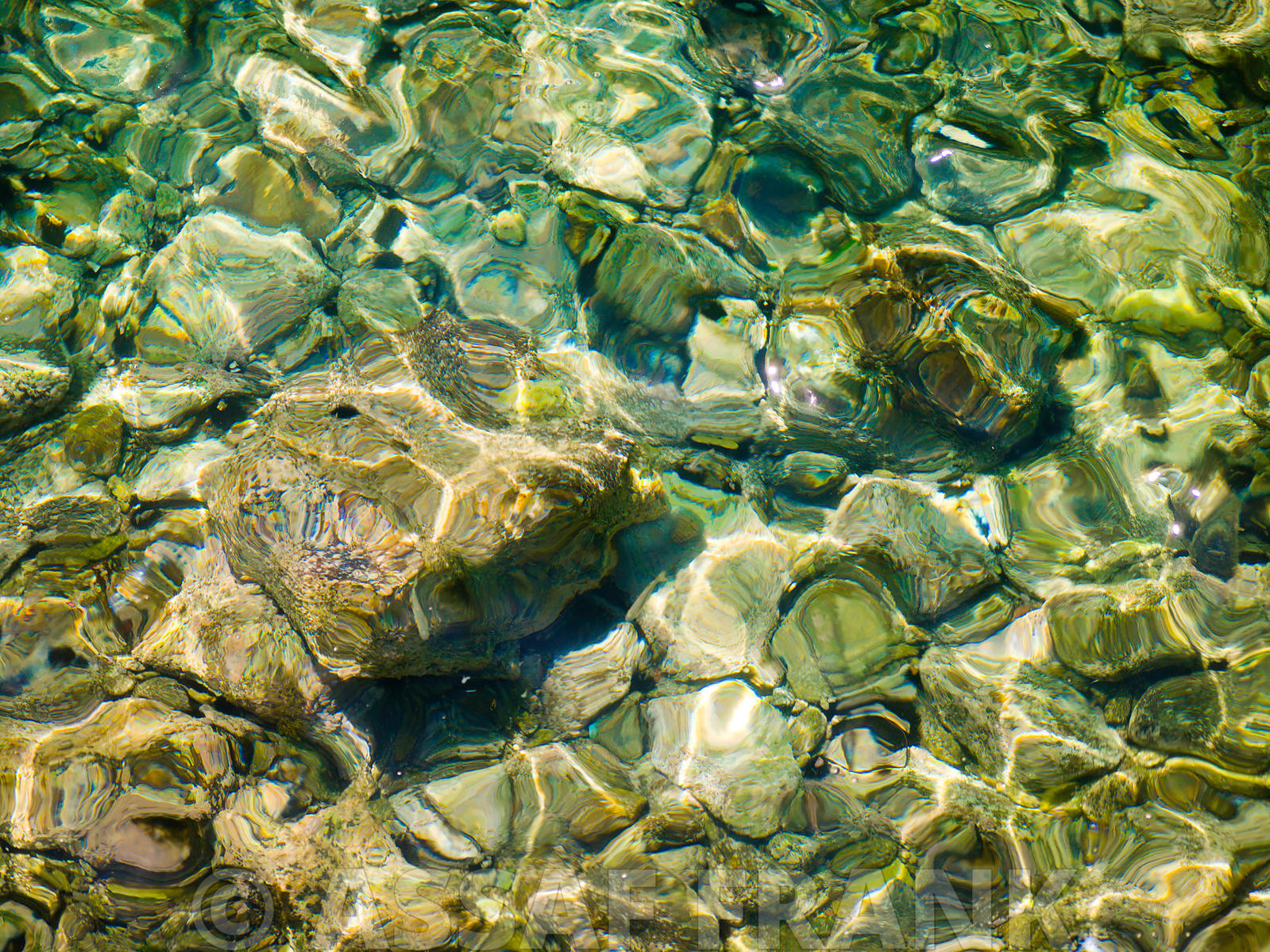 Mykonos, Small rocks in sea, close-up