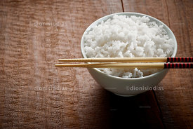 Bowl of rice in close up with hashi horizontal