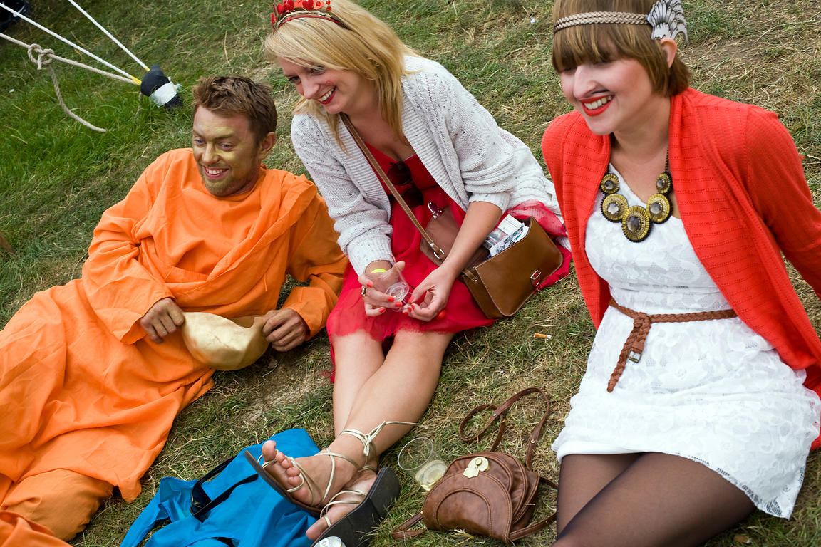 UK - Standon - Two women and a man in costume laugh whilst enjoying music at the Standon Calling Festival